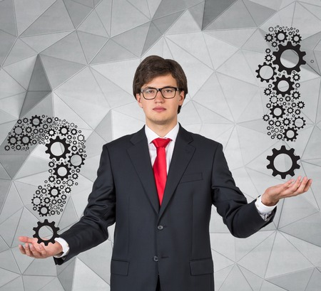 exclamation mark: young businessman holding question and exclamation mark
