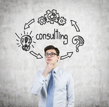 Young businessman thinking  consulting concept photo