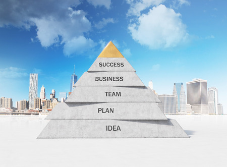 business communication: pyramid composed of business concepts on city background