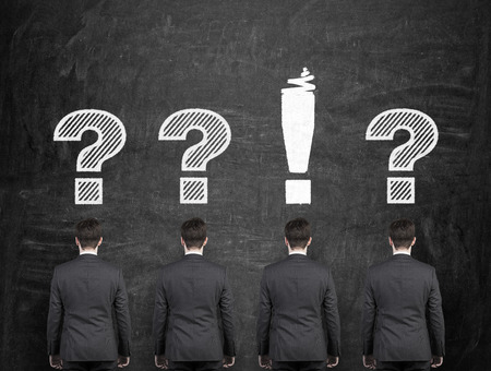 query mark: four businessman with exclamation and question mark over head