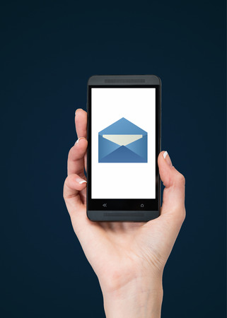 hand holding phone with email on blue background photo