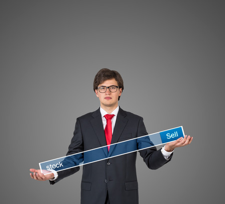 adwords: young businessman hand holding search field on gray background