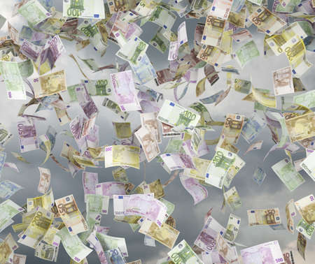 five hundred euro bills falling on sky background photo