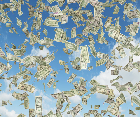 money falling: dollar banknote falling on a blue sky background