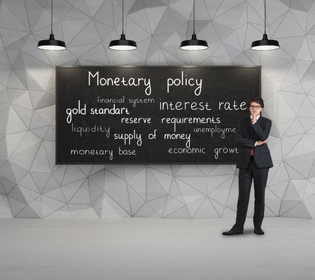 gold standard: young businessman thinking with business statement Stock Photo