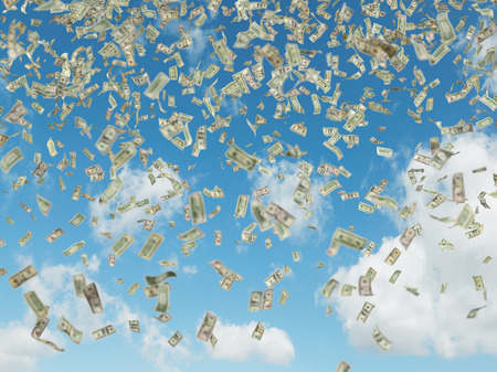 person falling: dollar bills flying on a blue sky background Stock Photo