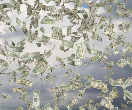 dollar banknote falling on a sky background photo