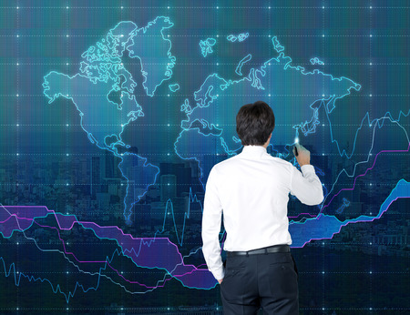 Businessman drawing world map on concrete wall stock photo businessman drawing world map on white concrete wall photo gumiabroncs Choice Image