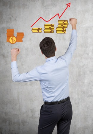happy businessman and coin with chart drawing on wall photo