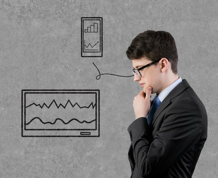 businessman thinking and drawing tablet with graphic photo