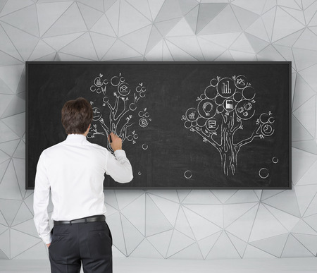 businessman drawing tree on blackboard photo