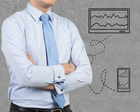 businessman and drawing tablet with graphic on wall photo