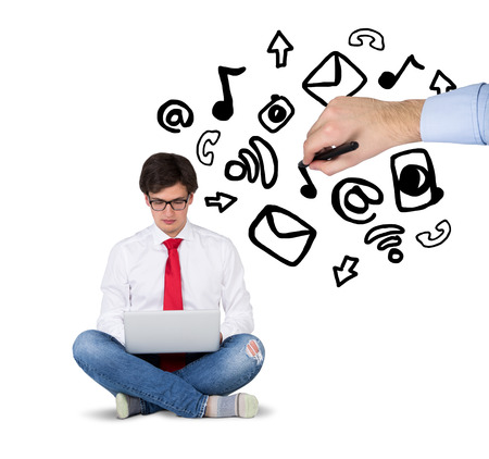 businessmen sitting with laptop and hand drawing media icons photo