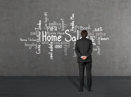 young businessman looking at home sales photo