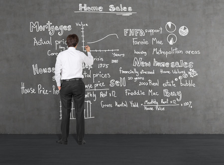 Businessman drawing at home sales photo