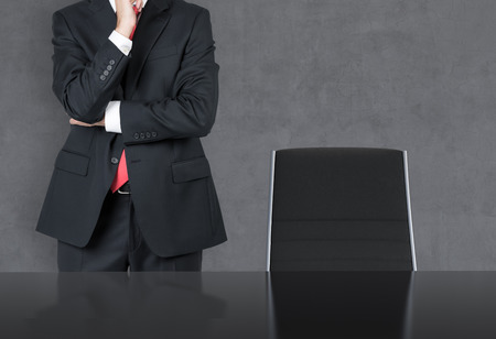 businessman thinking standing in office photo