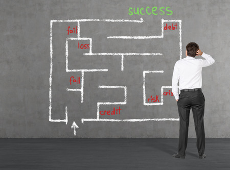 businessman looking for a way out of labyrinth