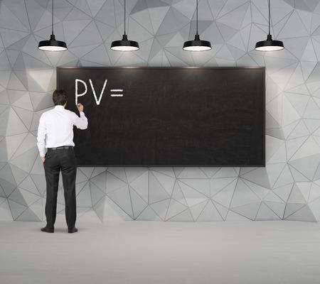 pv: Businessman drawing PV concept on blackboard Stock Photo