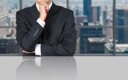 businessman thinking sitting in office, close up photo