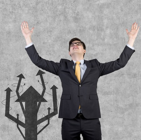 drawing arrow: happy businessman and drawing arrow tree on wall