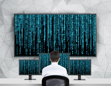 information international: businessman looking to screen with matrix background