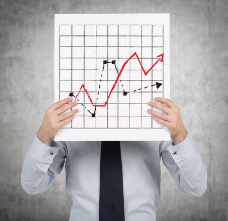 gripping bars: businessman holding placard with drawing chart and arrow Stock Photo