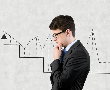 businessman thinking and charts drawing on wall photo