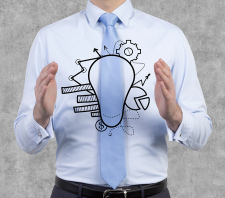 business symbol: businessman holding lamp with business symbol