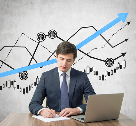 Businessmen working in office with drawing graph on wall photo