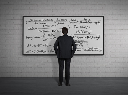 mathematical proof: Businessman standing and looking to board with mathematic formulas