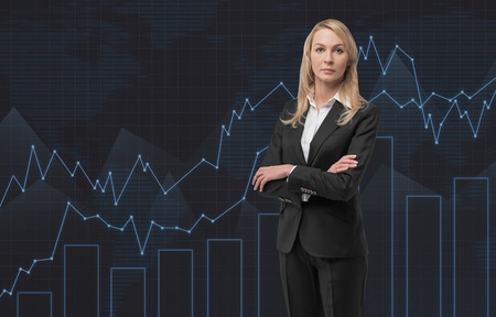 big screen: businesswoman standin in room and big screen with chart
