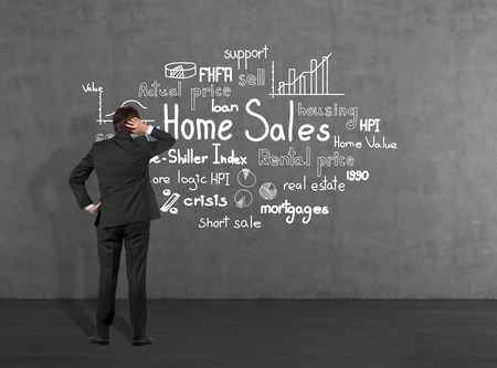 Businessman looking at home sales photo