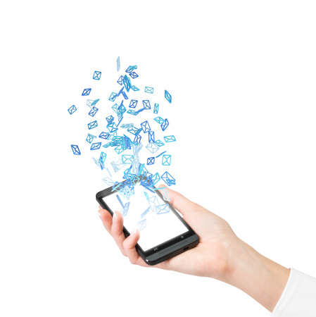 hand holding cellphone with flying email icon photo
