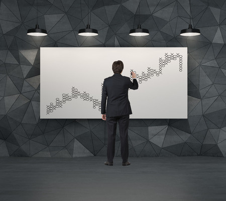 tic tac toe: businessman drawing graph in form tic tac toe on placard Stock Photo