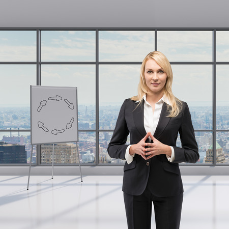 drawing arrow: businesswoman standing in office, poster with drawing arrow