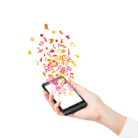 hand holding cellphone with flying email symbol photo