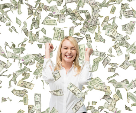 confident woman: happy beautiful businesswoman and falling money Stock Photo