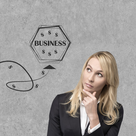 businesswoman looking on drawing business icons  isolation on gray photo