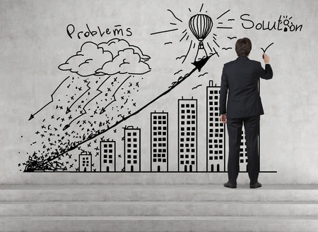 solution concept: businessman drawing problem and solution concept Stock Photo