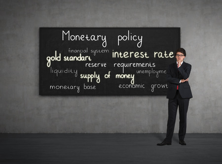 monetary policy: Businessman think about monetary policy at the poster