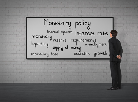 monetary policy: Businessman looking to monetary policy at the poster