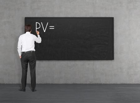 pv: Businessman drawing PV on blackboard Stock Photo