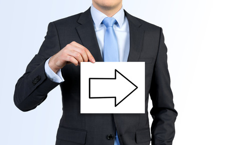 drawing arrow: businessman holding white poster with drawing arrow