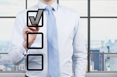 businessman drawing checmark into checkbox photo