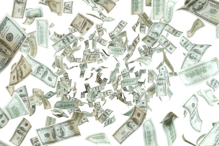 dollar bills falling on a white background photo