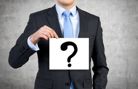question mark: businessman holding poster with drawing question mark
