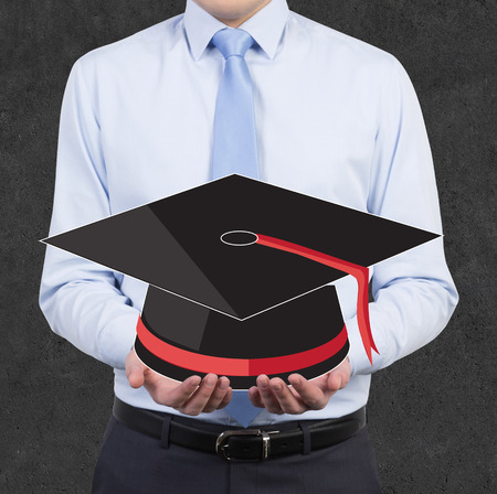 bachelor: businessman holding hat Bachelor in hand Stock Photo