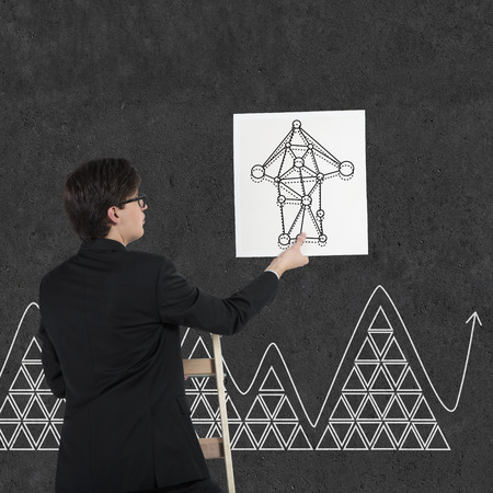 drawing arrow: businessman holding poster with drawing arrow Stock Photo