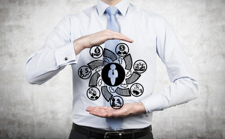 creative planning: businessman holding drawing business symbol in hand Stock Photo