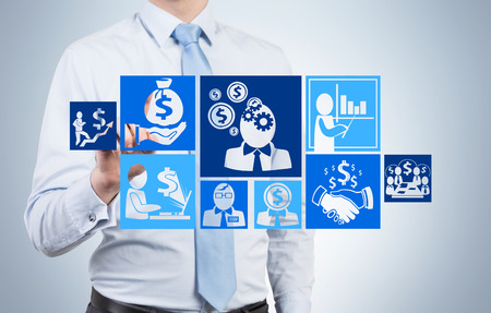 investment solutions: businessman drawing business plan with icons Stock Photo